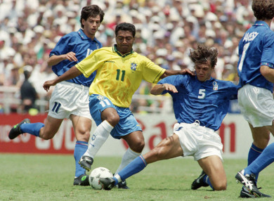 Brazil's Romario, centre, maneuvers the ball between Italian defenders Paolo Maldini (5) and Demetrio Albertini (11) during World Cup final match, Sunday, July 17, 1994, at the Rose Bowl in Pasadena, Calif. (AP Photo/Thomas Kienzle)
